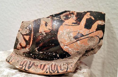 AN ANCIENT GREEK TERRACOTTA POTTERY FRAGMENT