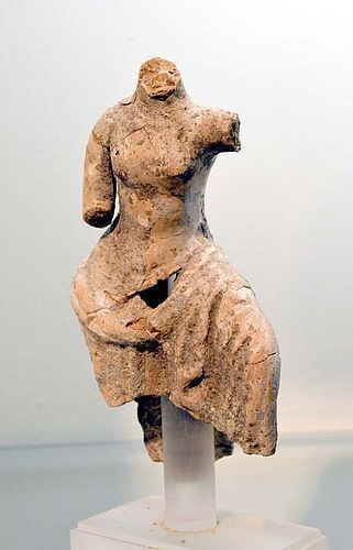 AN ANCIENT GREEK TERRACOTTA FEMALE TORSO