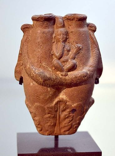 AN ANCIENT EGYPTIAN TERRACOTTA DOUBLE UNGUENTARIUM