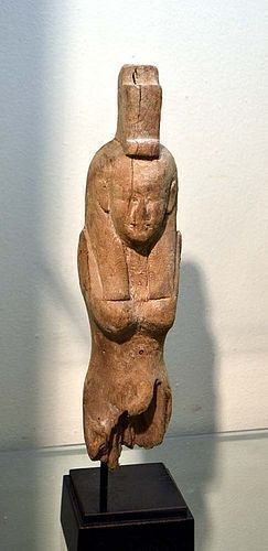 AN ANCIENT EGYPTIAN WOOD ISIS