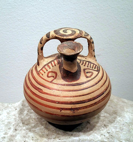 A MYCENAEAN POTTERY STIRRUP-SPOUT JAR