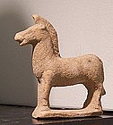 AN ANCIENT GREEK TERRACOTTA HORSE