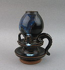 A Finely Black Glaze Oil Lamp With Purple Splashes