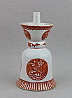 A CORAL-RED PHOENIX MEDALLIONS OIL LAMP