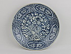 A MING SWATOW/ZHANGZHOU WARE WHITE ON BLUE DISH