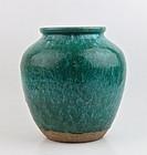 A LATE MING SHIWAN WARE PEACOCK GREEN GLAZE JAR