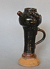 AN ELEGANT SHAPE OF SONG DYNASTY BLACK GLAZE OIL LAMP WITH A MOUSE