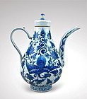 YUAN DYNASTY STYLE  BLUE & WHITE EWER WITH PHOENIX FLIGHT AMONG LOTUS