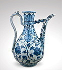 A MAGNIFICENT EARLY MING HONGWU STYLE B/W EWER WITH PEONY SCROLL