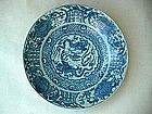 A Large Blue & White Dish With Dragons