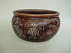 A Rare Brown Glazed Jar With Four Handles