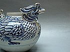 A RARE MUSEUM PIECE DOUBLE HEADED M-DUCK WATER DROPPER