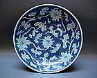 A WHITE ON BLUE KANGXI PERIOD DISH