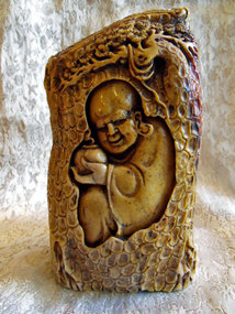 Shoushan stone carving of a lohan in his cave (China)
