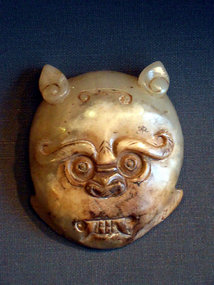 A Chinese jade belt buckle