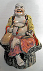 Stoneware Budai or Hotei statue, China