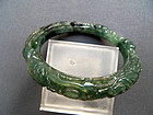 Burmese carved dark green jade bracelet
