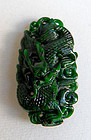 Chinese dark green jade pendant with dragon