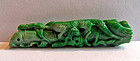 Chinese apple green jade pendant with a mythical dragon