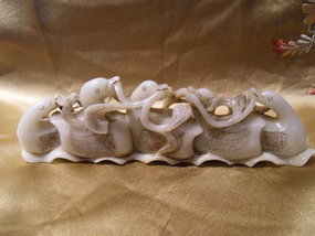 Chinese nephrite jade brush rest with a duck family