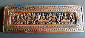 Wooden Tibetan sutra book cover with 9 Buddhas