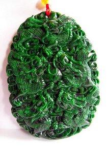 Carved dark green jade pendant