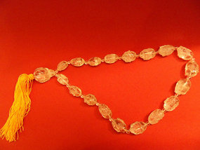 Chinese carved rock crystal mala with an image of Budai