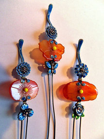 Three silver hairpins with carnelian pieces and enamel