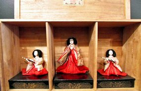 Three Japanese dolls in the original wooden box