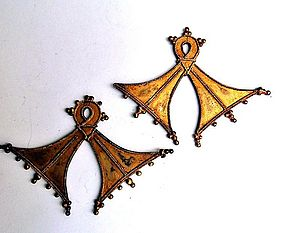 Traditional gold pectoral ornaments from the Moluccas