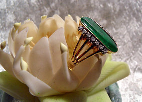 Gold ring with dark green jadeite and diamonds
