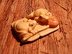 Netsuke with two frogs and a lotus flower