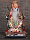 Wooden statue of Tu Di Gong, the Chinese earth God