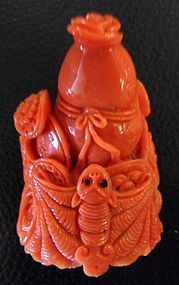 Red coral carving of a double gourd and a bat