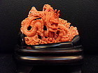 Red coral carving of a dragon with the pearl