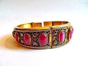 Antique gold enameled bracelet with rubies and diamond
