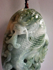 Jade carving of a dragon with a fish tail and horns