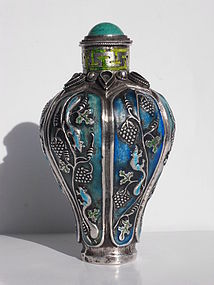 Chinese silver enameled snuff bottle with relief decor
