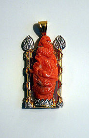 Red coral pendant of a dragon mounted in gold