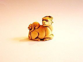 Japanese netsuke of a ram and a monkey
