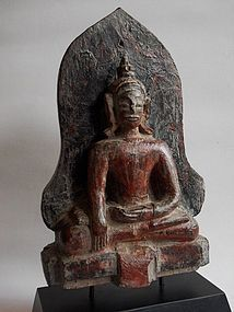 Antique sitting wood Buddha from Laos