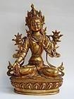 Tibetan fire gilt bronze White Tara statue