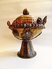 Tibetan skull cup or kapala on a purple copper stand