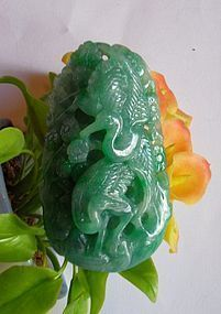 Jade pendant - two crane birds building a nest