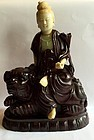 Chinese nephrite jade and wood carving statue of Guanyin on a lion