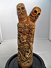 Tibetan magic carved bone object with two skulls