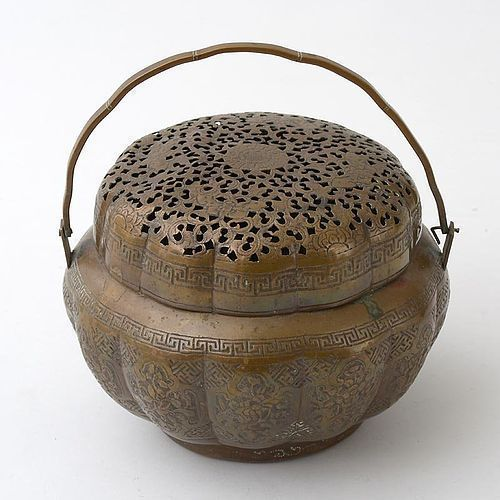 A Chinese Lobed Copper Handwarmer with Openwork, Qing.