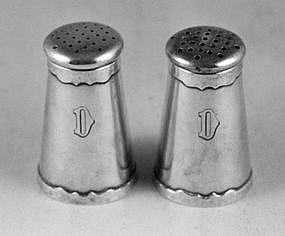 Pair of salt and pepper shakers by Shreve & Co.