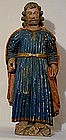 A Carved And Painted Wood Santos Figure