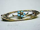 A Vintage Gold And Enamel Oval  brooch With Flower